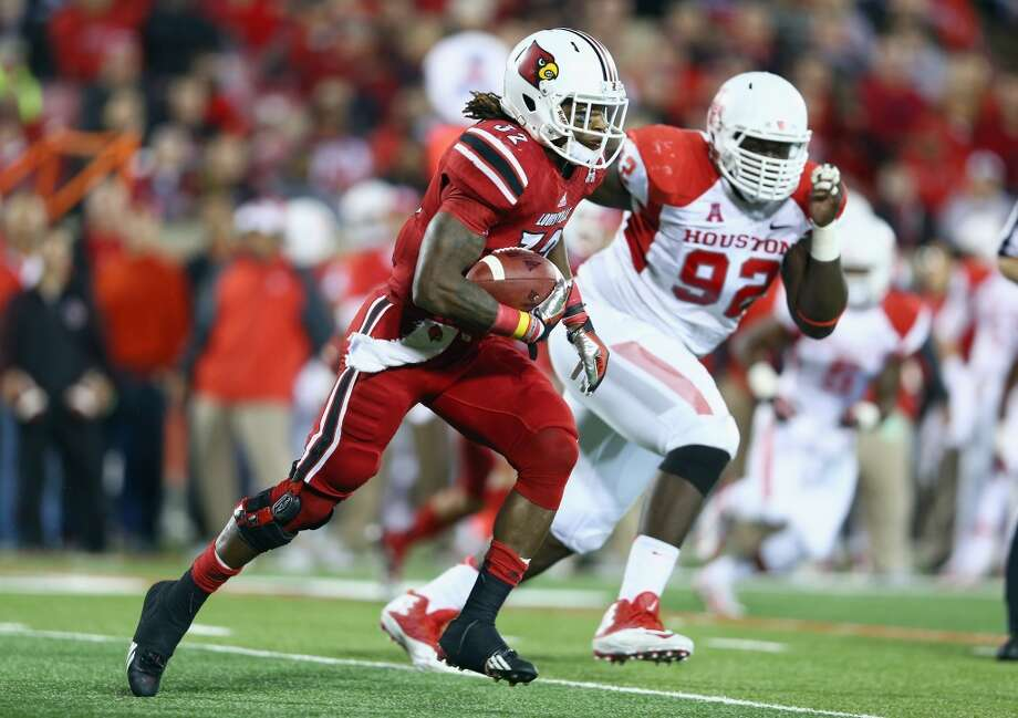 Senorise Perry #32 of the Cardinals runs with the ball. Photo: Andy Lyons, Getty Images