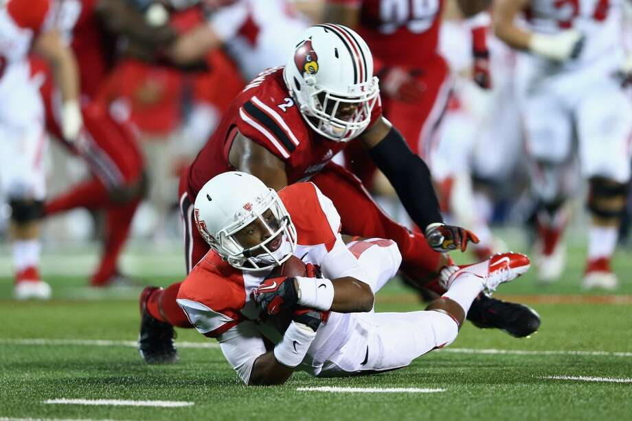 Greg Ward Jr #1 of the Cougars dives forward for yardage. Photo: Andy Lyons, Getty Images