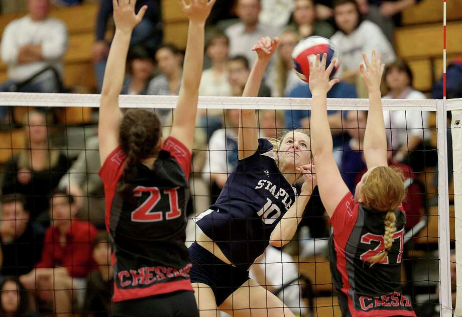 Staples High School's #10 Amelia Brackett shoots through Cheshire High School's #21 Jill Howard and #27 Laura Heynen during Saturday evening Class LL Finals in Berlin. Staples would lose 3-1. Photo: Mike Ross / Mike Ross Connecticut Post freelance - @www.mikerossphoto.com