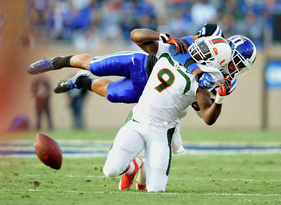 Once the team on the receiving end of the punishment, Duke is dishing it out this days as Jeremy Cash, top,  breaks up a pass intended for Miami's Malcolm Lewis Photo: Grant Halverson, Stringer / 2013 Getty Images