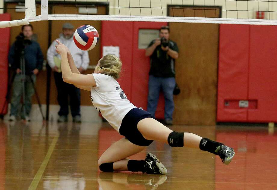 Staples High School's captain #22 Valerie Kirsch dives for a save during Saturday evening Class LL Finals against Cheshire High School. Staples would lose 3-1. Photo: Mike Ross / Mike Ross Connecticut Post freelance - @www.mikerossphoto.com