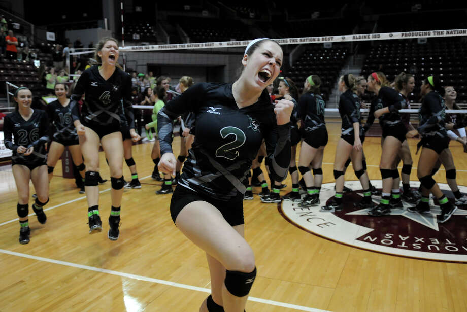 Clear Falls senior Kacey Stephenson leads the Knights in a celebration of their first trip to the state volleyball tournament after only three varsity seasons. Photo: Jerry Baker, Freelance