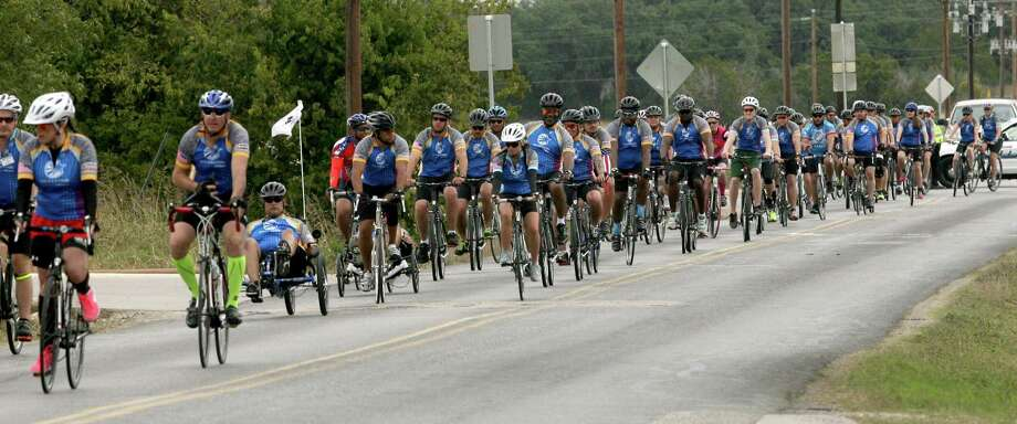 The Wounded Warrior Project provides at no cost state-of-the-art cycling equipment to veterans. After Saturday's cycling, the veterans had a chance to cool down and stretch with a yoga class. On Friday, some played golf. Photo: Cynthia Esparza / For San Antonio Express-News