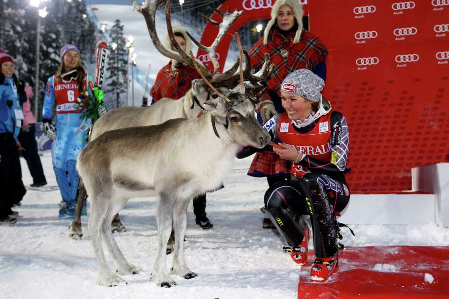 Mikaela Shiffrin of the U.S. earns a congratulatory visit from a pair of reindeer after her slalom victory. Photo: Christophe Pallot/Agence Zoom, Stringer / 2013 Getty Images