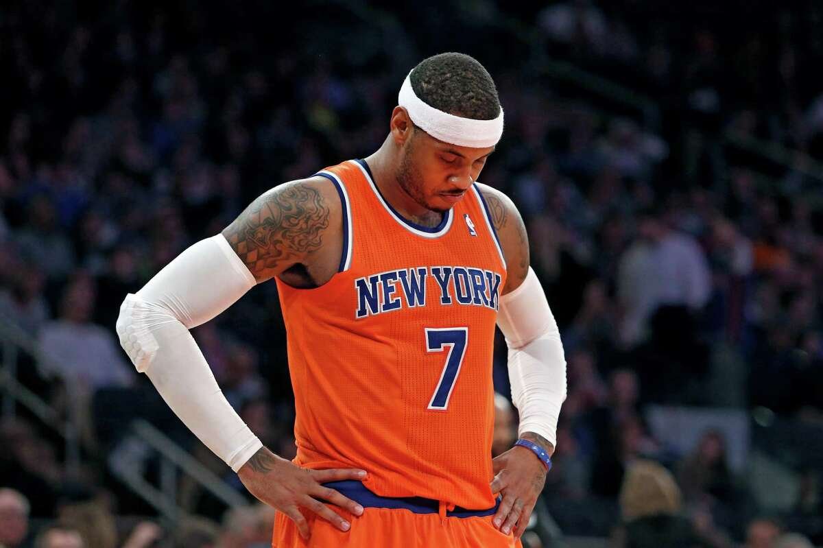 New York Knicks' Carmelo Anthony (7) waits during a break late in the second half action of an NBA basketball game against the Atlanta Hawks Saturday, Nov. 16, 2013, in New York. Atlanta defeated New York 110-90. (AP Photo/Jason DeCrow) ORG XMIT: NYJD117