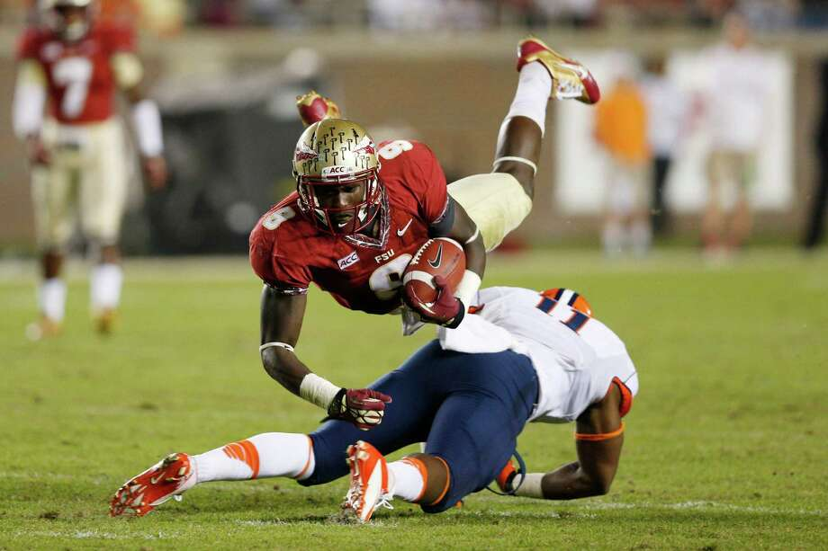 TALLAHASSEE, FL - NOVEMBER 16: Karlos Williams #9 of the Florida State Seminoles gets upended while running with the ball against the Syracuse Orange during the game at Doak Campbell Stadium on November 16, 2013 in Tallahassee, Florida. (Photo by Joe Robbins/Getty Images) ORG XMIT: 188114608 Photo: Joe Robbins / 2013 Getty Images