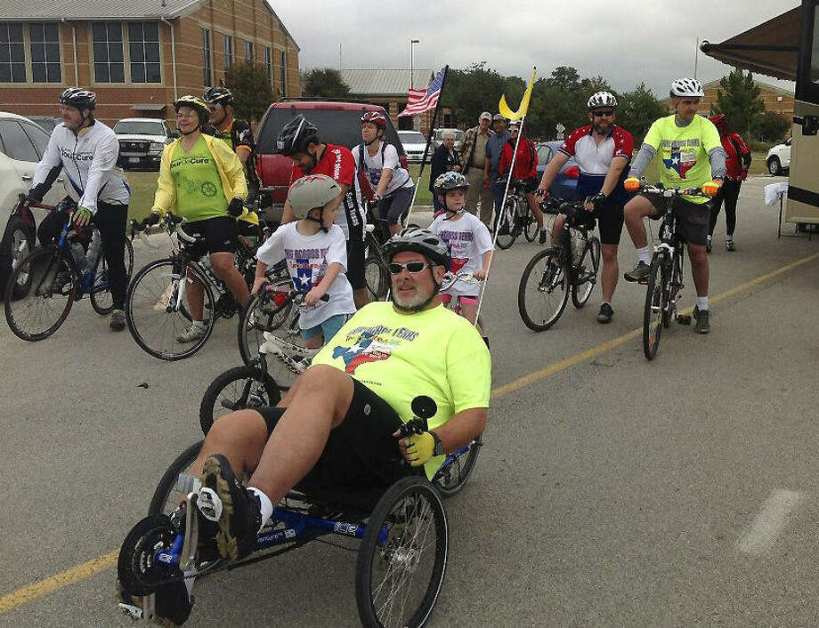 Ray McCutcheon rides his tricycle in San Antonio as part of his 1,027-mile trek across Texas. Photo: Courtesy Photo
