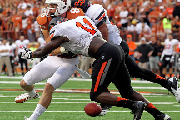 After winning six in a row, UT was jolted back to reality Saturday by Oklahoma State, with Longhorns receiver Jordan Shipley (8) feeling the sting from a pair of Cowboys defenders.