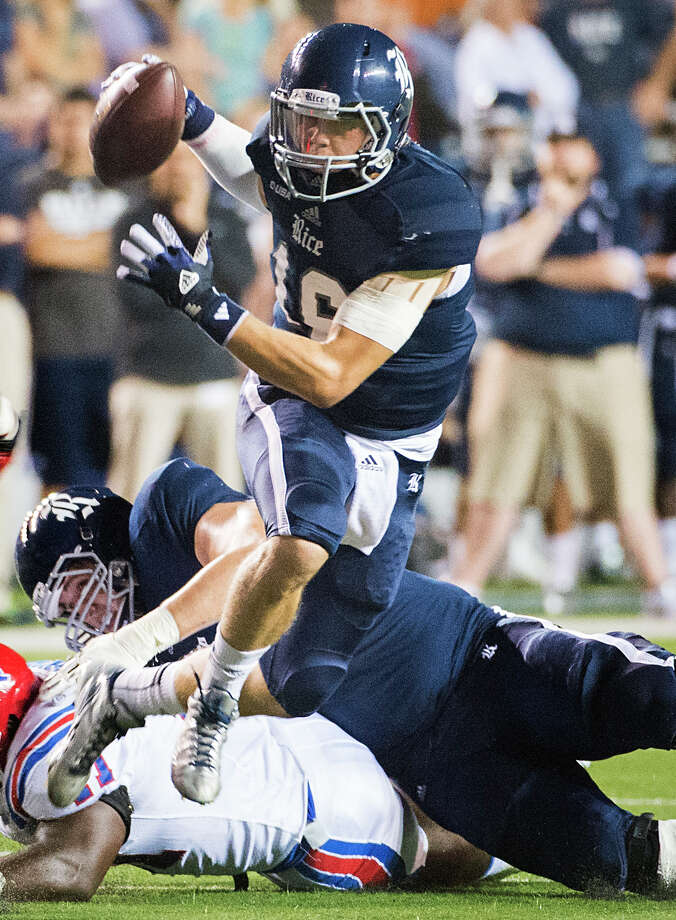 Rice quarterback Taylor McHargue shows some nimble footwork on a first-half scramble. Photo: Smiley N. Pool, Staff / © 2013  Houston Chronicle