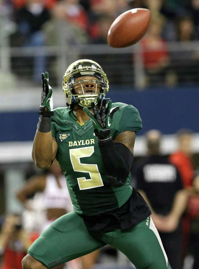 Baylor wide receiver Antwan Goodley reaches to catch a touchdown pass during the first half of an NCAA college football game against the Texas Tech in Arlington, Texas, Saturday, Nov. 16, 2013. (AP Photo/LM Otero) Photo: LM Otero, Associated Press / AP