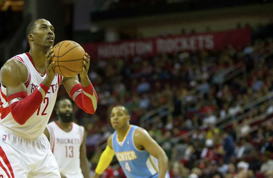 The Rockets' Dwight Howard takes aim while at the free-throw line, from where he hit 17 of 24 attempts. Photo: Cody Duty, Staff / © 2013 Houston Chronicle