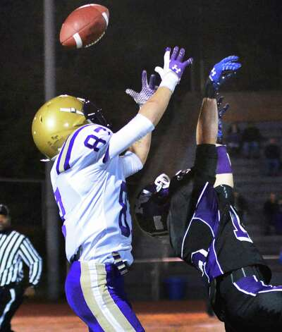 CBA's  #87 Austin Ellis, left, beats Monroe-Woodbury's #12 Jesse Kaffenberger to complete this pass and run it in for a TD during the Class AA regional semifinal Saturday Nov. 16, 2013, at Dietz Stadium Kingston, NY.  (John Carl D'Annibale / Times Union) Photo: John Carl D'Annibale / 00024620A