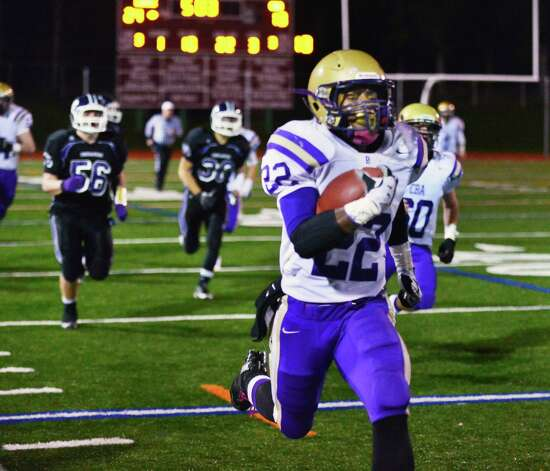 CBA's #22 Elliot Crosky outruns Monroe-Woodbury defenders for a touchdown during the Class AA regional semifinal Saturday Nov. 16, 2013, at Dietz Stadium Kingston, NY.  (John Carl D'Annibale / Times Union) Photo: John Carl D'Annibale / 00024620A