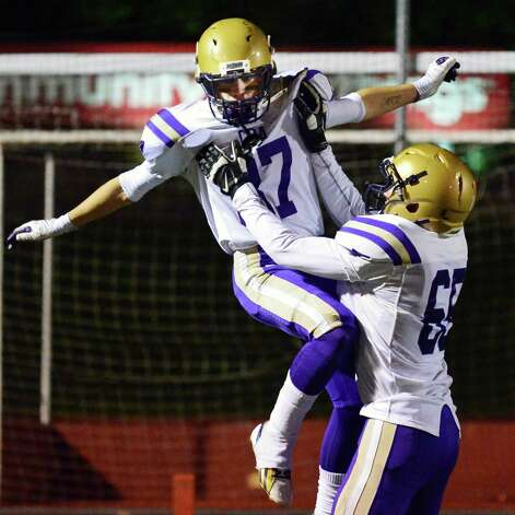CBA's  #87 Austin Ellis, left, and #65 Patrick Pastore celebrate Ellis's TD against Monroe-Woodbury during the Class AA regional semifinal Saturday Nov. 16, 2013, at Dietz Stadium Kingston, NY.  (John Carl D'Annibale / Times Union) Photo: John Carl D'Annibale / 00024620A
