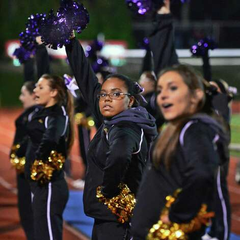 CBA cheerleader Alex Beckford, center, during the Class AA regional semifinal against Monroe-Woodbury Saturday Nov. 16, 2013, at Dietz Stadium Kingston, NY.  (John Carl D'Annibale / Times Union) Photo: John Carl D'Annibale / 00024620A