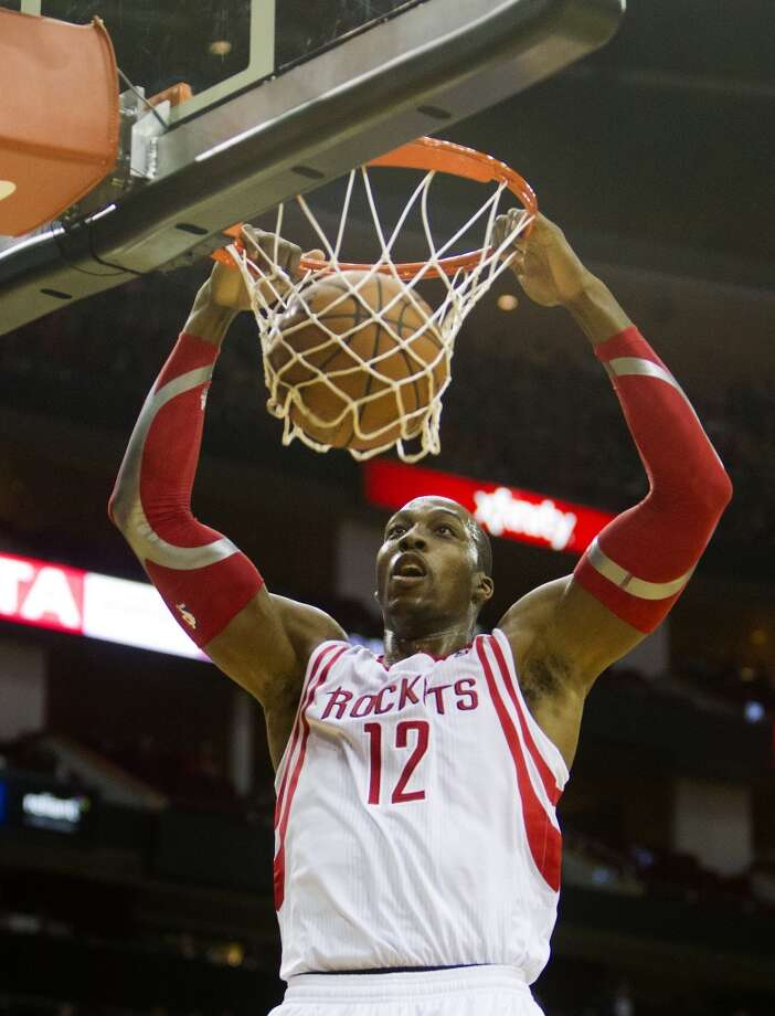 Nov. 16: Rockets 122, Nuggets 111   Rockets power forward Dwight Howard dunks. Photo: Cody Duty, Houston Chronicle