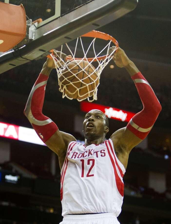 Nov. 16: Rockets 122, Nuggets 111Rockets power forward Dwight Howard dunks. Photo: Cody Duty, Houston Chronicle