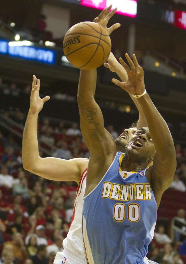 Nuggets power forward Darrell Arthur, left, can't come up with the rebound as he's pressured by Rockets small forward Omri Casspi. Photo: Cody Duty, Houston Chronicle