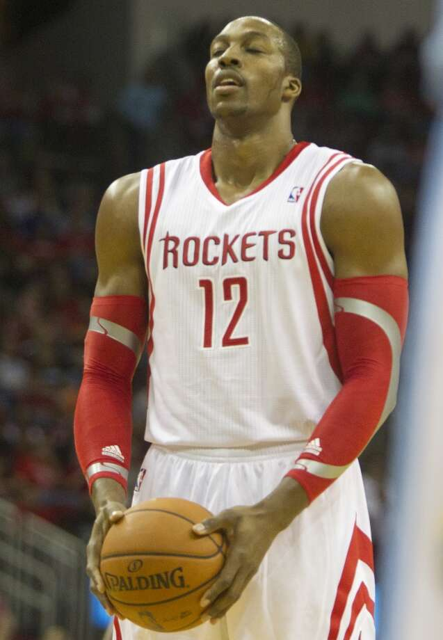 Rockets power forward Dwight Howard takes a moment before shooting a free-throw. Photo: Cody Duty, Houston Chronicle