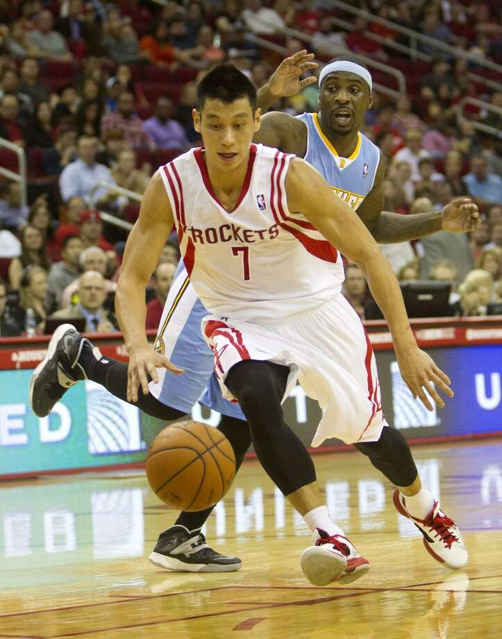 Rockets point guard Jeremy Lin dribbles past Nuggets point guard Ty Lawson. Photo: Cody Duty, Houston Chronicle