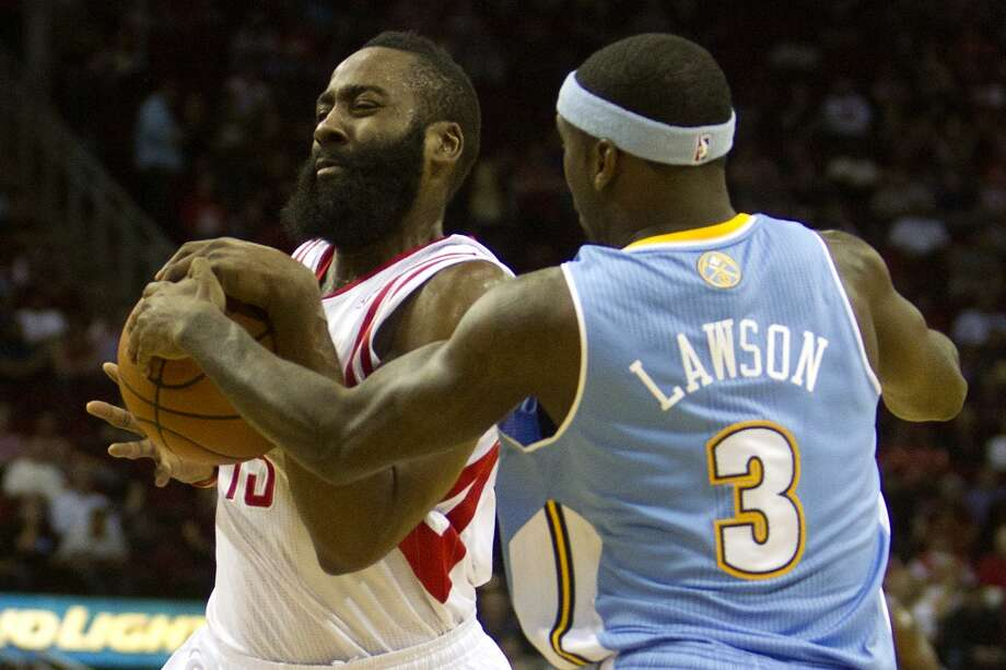 Rockets shooting guard James Harden drives toward the basket as Nuggets point guard Ty Lawson pressures. Photo: Cody Duty, Houston Chronicle