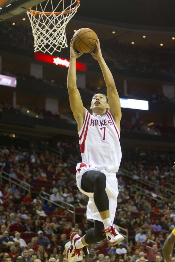 Rockets point guard Jeremy Lin drives toward the basket. Photo: Cody Duty, Houston Chronicle