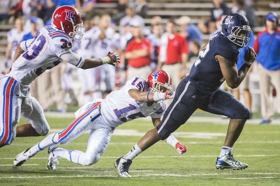 Nov. 16: Rice 52, Louisiana Tech 14Record: 7-3Rice running back Charles Ross (12) gets past Louisiana Tech cornerback Bryson Abraham (15) and safety Thomas McDonald (33) to score on a 19-yard touchdown run for his school record fifth touchdown of the game. Photo: Smiley N. Pool, Houston Chronicle