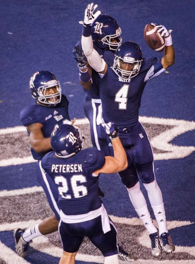 Rice wide receiver Dennis Parks (4) celebrates with teammates after scoring on a 41-yard touchdown reception during the first half. Photo: Smiley N. Pool, Houston Chronicle