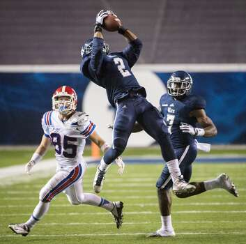 Rice safety Malcolm Hill (2) intercepts a pass intended for Louisiana Tech wide receiver Trent Taylor (85). Photo: Smiley N. Pool, Houston Chronicle