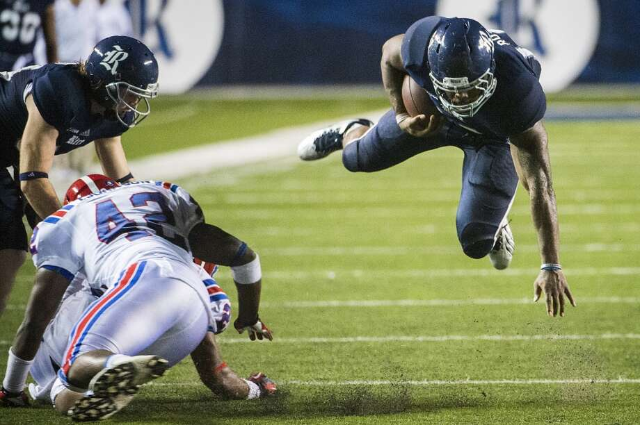Rice running back Charles Ross dives for a first down during the second half. Ross ran for 215 yards and set the school record with five touchdowns in the game. Photo: Smiley N. Pool, Houston Chronicle