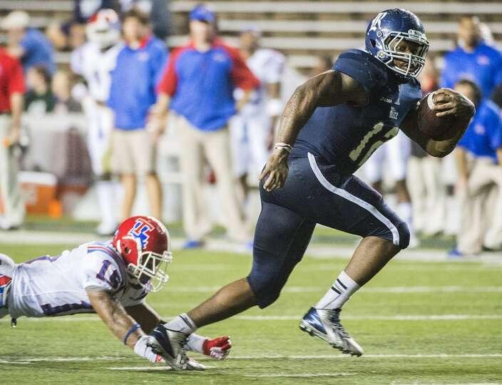 Rice running back Charles Ross (12) gets past Louisiana Tech cornerback Bryson Abraham (15) to score