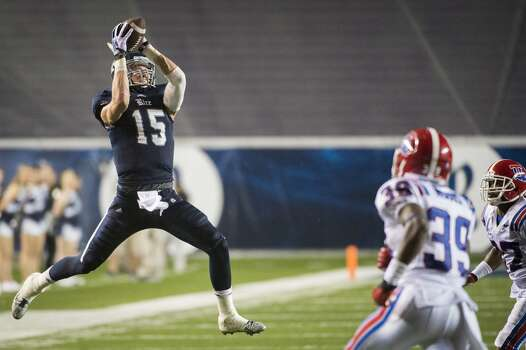 Rice wide receiver Jordan Taylor leaps to catch a pass during the second half. Photo: Smiley N. Pool, Houston Chronicle