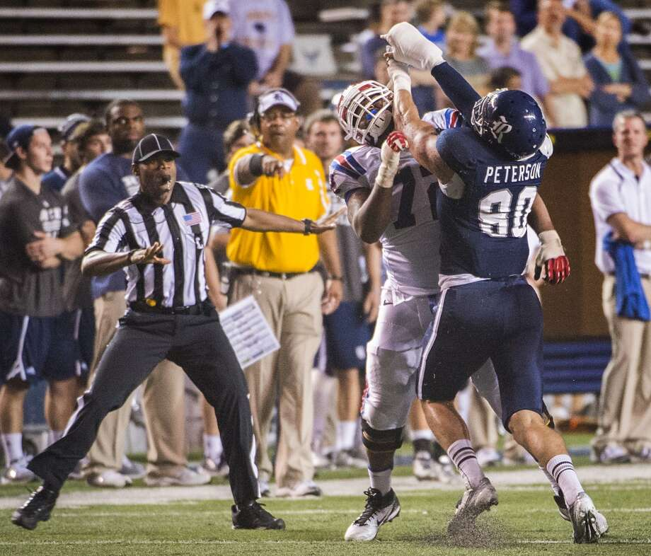 Rice defensive end Grant Peterson (80) commits a personal foul penalty with a hit on Louisiana Tech offensive linesman Jeremy Graffree (72) after the whistle. Photo: Smiley N. Pool, Houston Chronicle