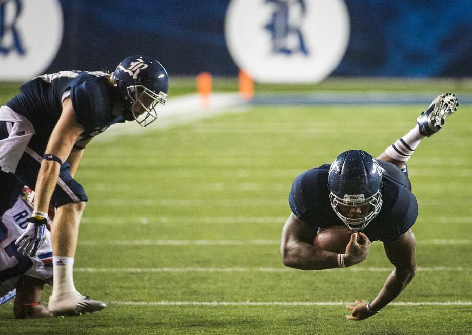 Rice running back Charles Ross dives for a first down. Photo: Smiley N. Pool, Houston Chronicle