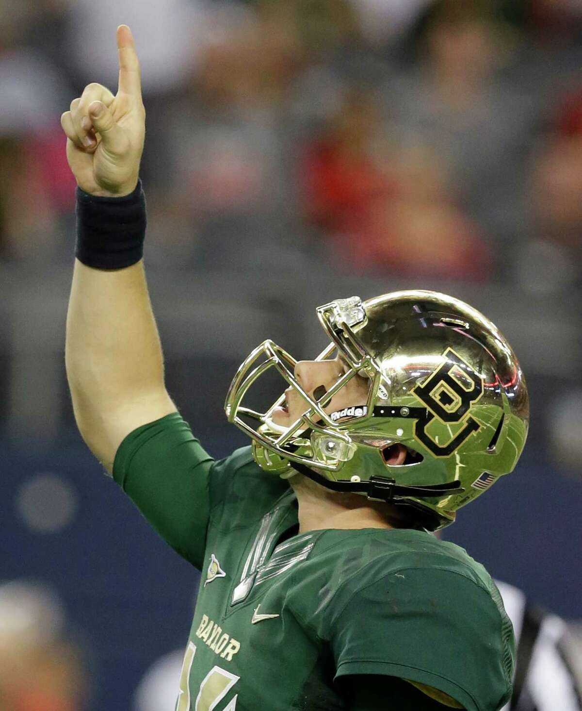 Baylor quarterback Bryce Petty points to the sky after his team scored a touchdown against Baylor during the second half of an NCAA college football game in Arlington, Texas, Saturday, Nov. 16, 2013. Baylor won 63-38. (AP Photo/LM Otero)