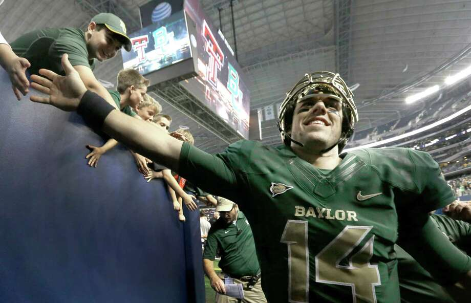 Baylor quarterback Bryce Petty walks off the field smiling after an NCAA college football game against Texas Tech in Arlington, Texas,  Saturday, Nov. 16, 2013. Baylor won 63-38.  (AP Photo/LM Otero) Photo: LM Otero, Associated Press / AP