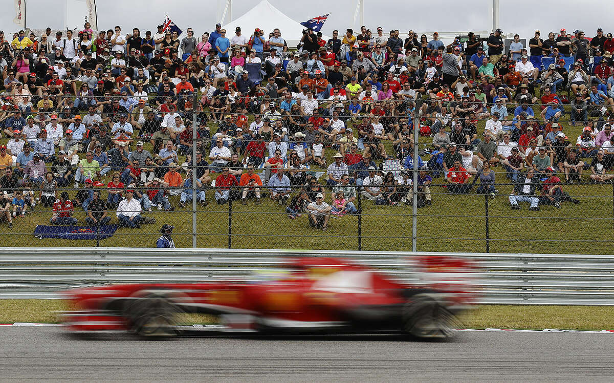 Fans at the Circuit of the Americas watch cars whiz past during practice for today's Formula One race in Austin. Sebastian Vettel, Mark Webber and Romain Grosjean will be the top three starters.