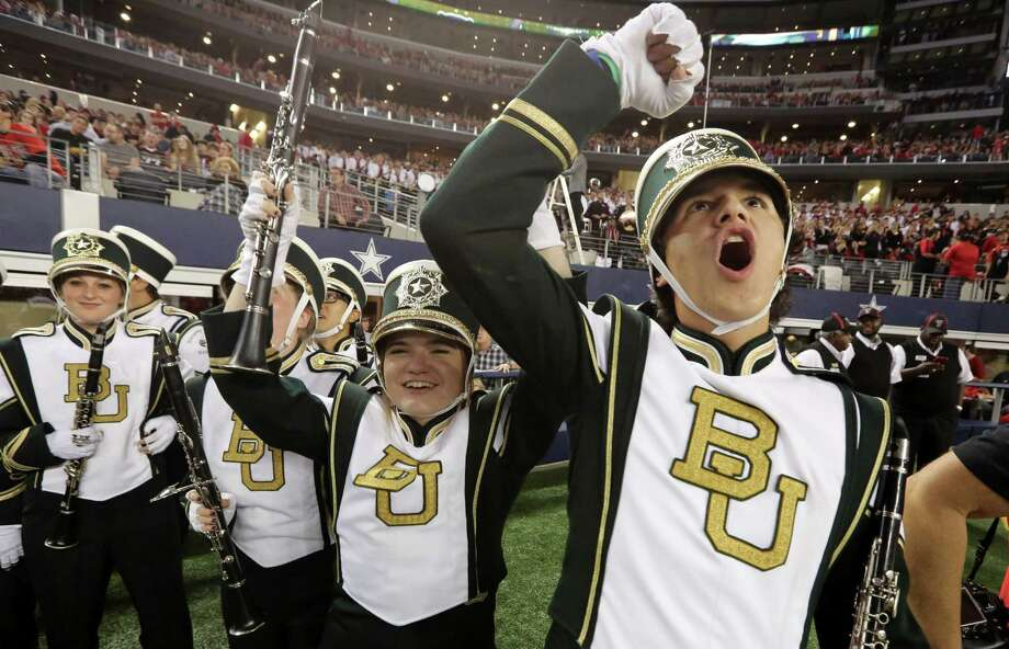 The Baylor band cheers on the sideline before an NCAA college football game against Texas Tech in Arlington, Texas,  Saturday, Nov. 16, 2013. (AP Photo/LM Otero) Photo: LM Otero, Associated Press / AP