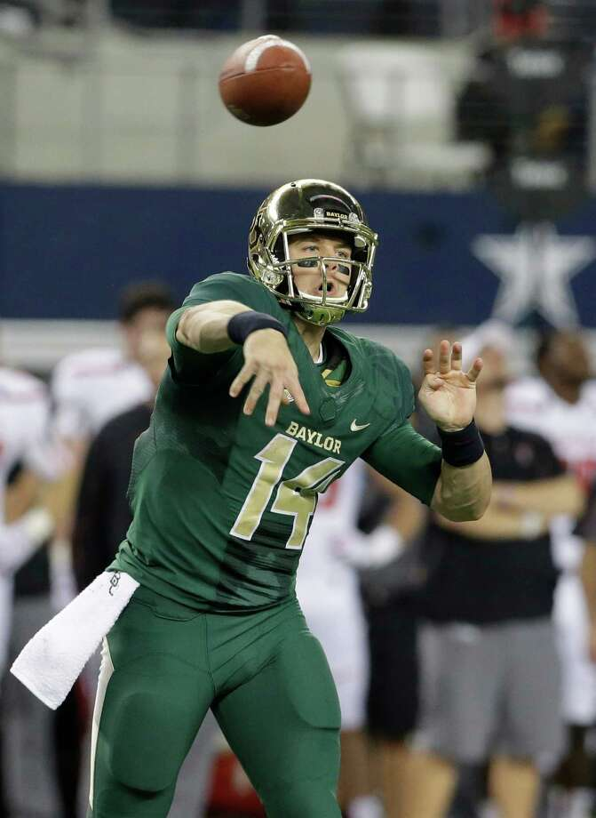 Baylor quarterback Bryce Petty passes during the second half of an NCAA college football game against Texas Tech in Arlington, Texas,  Saturday, Nov. 16, 2013.    (AP Photo/LM Otero) Photo: LM Otero, Associated Press / AP