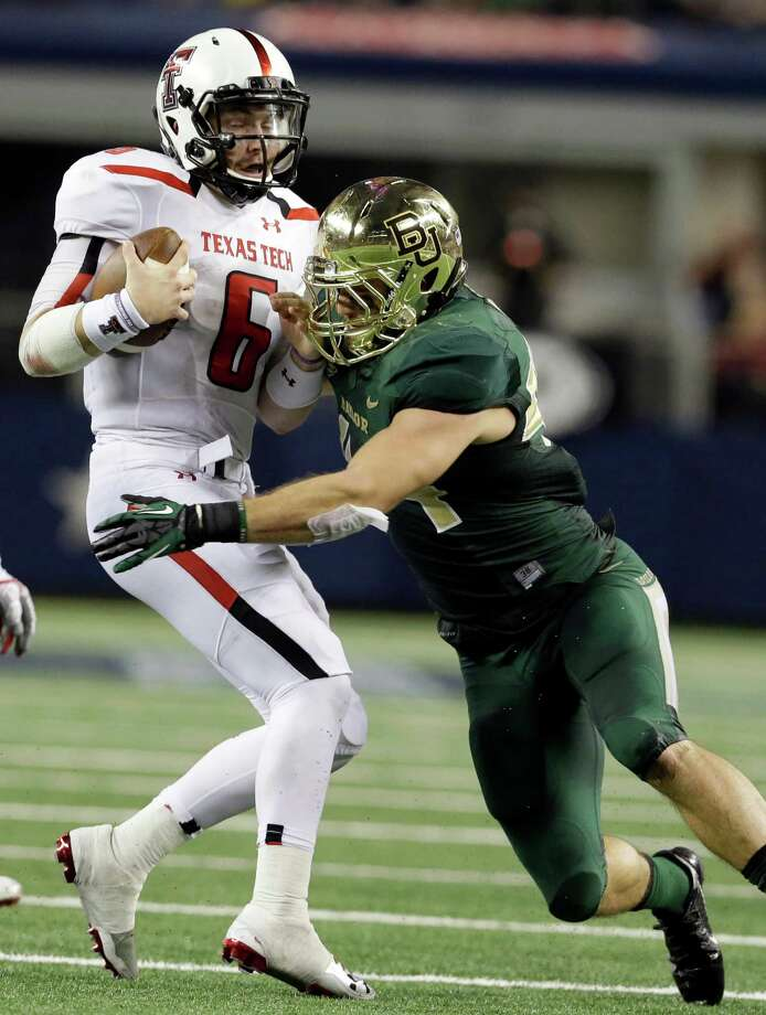 Texas Tech quarterback Baker Mayfield (6) is grabbed by Baylor linebacker Bryce Hager during the first half of an NCAA college football game in Arlington, Texas, Saturday, Nov. 16, 2013. (AP Photo/LM Otero) Photo: LM Otero, Associated Press / AP