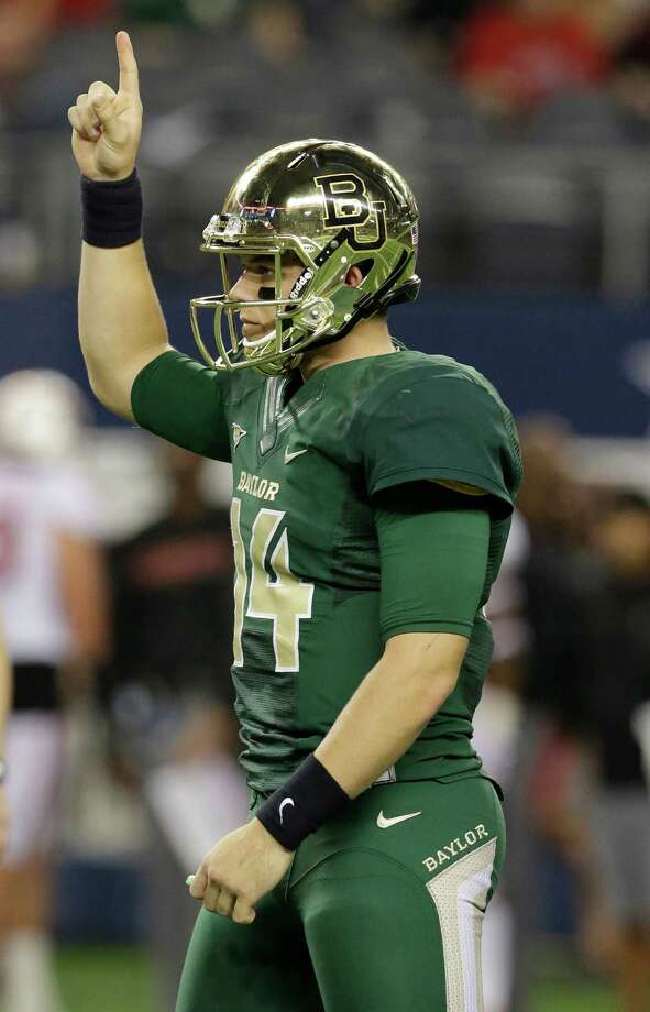 Baylor quarterback Bryce Petty (14) points to the sky after his team scored a touchdown against Baylor during the second half of an NCAA college football game in Arlington, Texas,  Saturday, Nov. 16, 2013.  (AP Photo/LM Otero) Photo: LM Otero, Associated Press / AP