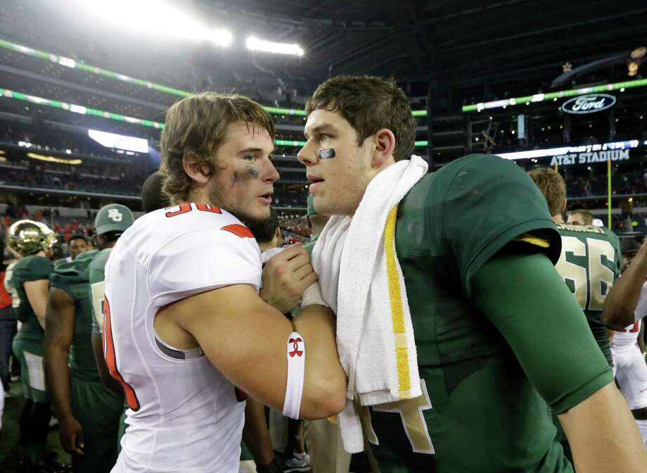 Baylor quarterback Bryce Petty, right, shakes hands with Texas Tech linebacker Tyler Scalzi (50)  after their NCAA college football game in Arlington, Texas,  Saturday, Nov. 16, 2013.  (AP Photo/LM Otero) Photo: LM Otero, Associated Press / AP