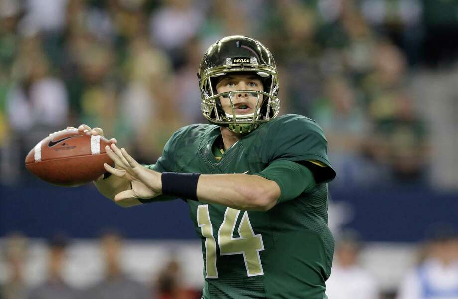 Baylor quarterback Bryce Petty (14) passes during the first half of an NCAA college football game against Baylor  in Arlington, Texas,  Saturday, Nov. 16, 2013. (AP Photo/LM Otero) Photo: LM Otero, Associated Press / AP