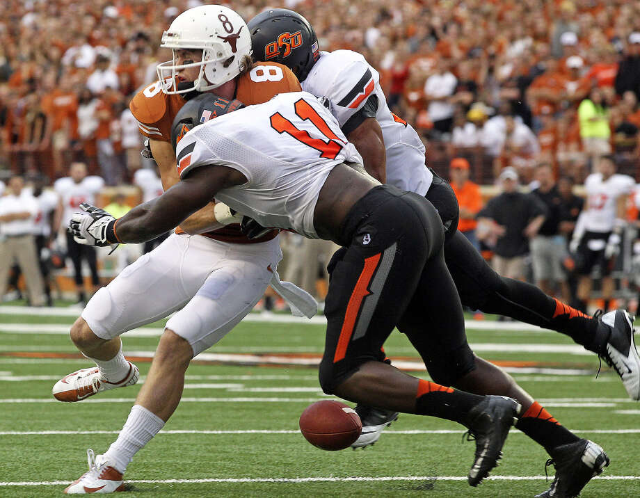 UT receiver Jordan Shipley can't hang onto the ball as he is sandwiched by Oklahoma State defenders in Austin. Photo: Tom Reel / San Antonio Express-News
