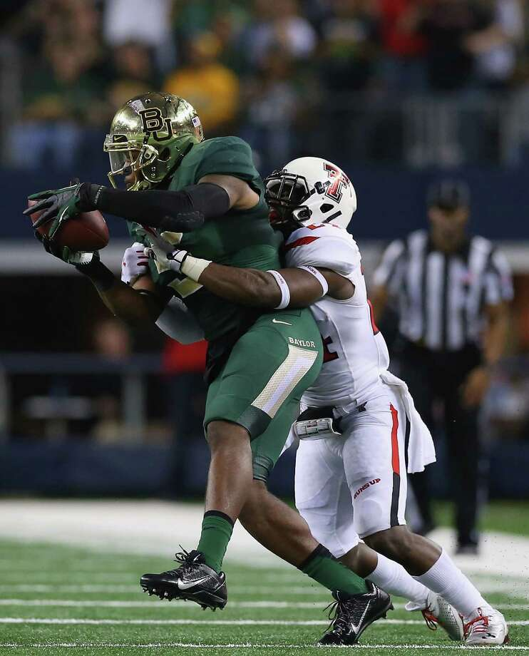 Baylor's Antwan Goodley, who scored the Bears' third touchdown on a 31-yard pass from Bryce Petty, pulls in one of his four catches in front of Texas Tech's Bruce Jones. Goodley finished with 101 receiving yards. Photo: Ronald Martinez, Staff / 2013 Getty Images