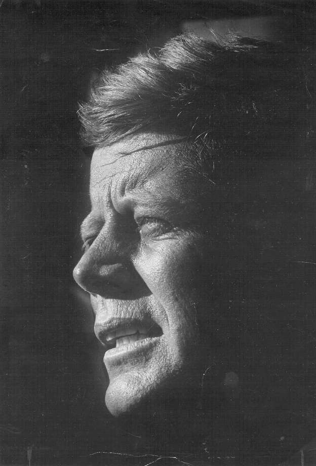 President John F. Kennedy is etched in bright sunlight at the San Antonio International Airport on Nov. 21, 1963, one day before he was assassinated in Dallas. Photo: San Antonio Light File Photo