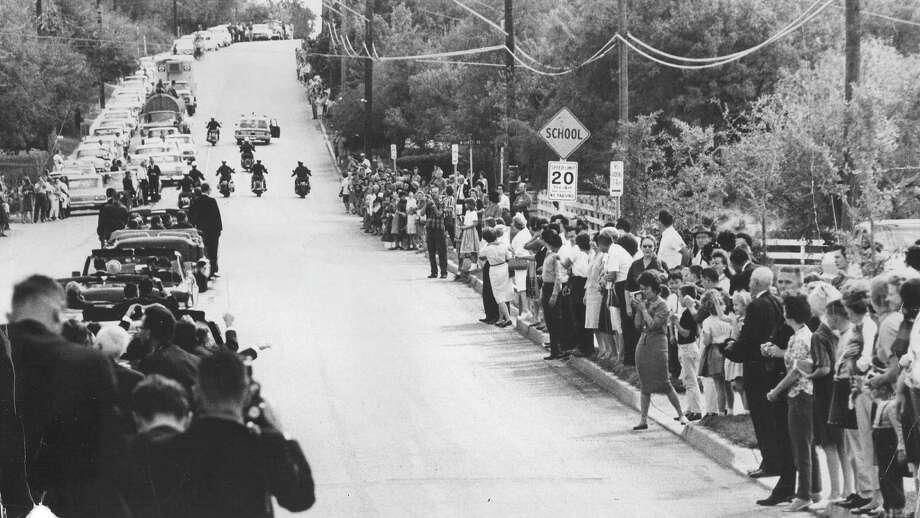 President John F. Kennedy's motorcade makes its way from the San Antonio International Airport to downtown on Nov. 21, 1963. Photo: San Antonio Light File Photo
