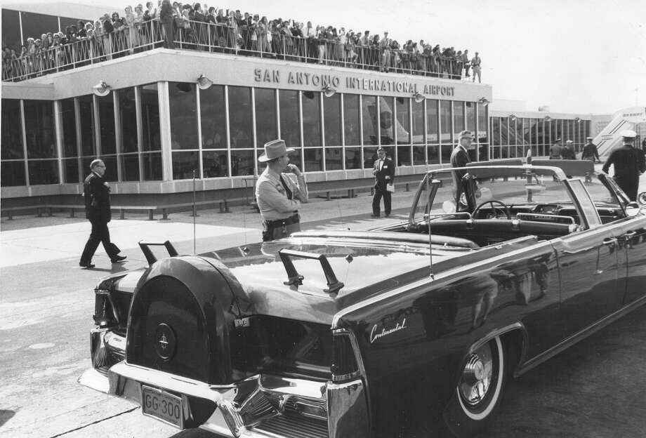 President John F. Kennedy's car waits as a crowd watches at the San Antonio International Airport on Nov. 21, 1963. Photo: San Antonio Light File Photo