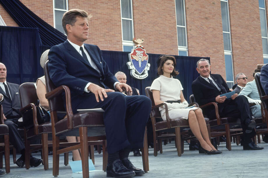 President John F. Kennedy, his wife Jacqueline Kennedy and Vice President Lyndon Johnson sit during the Aerospace Medical Health Center dedication ceremony at Brooks AFB in San Antonio on Nov. 21, 1963. Photo: Art Rickerby, Time & Life Pictures Via Getty Images / Time & Life Pictures