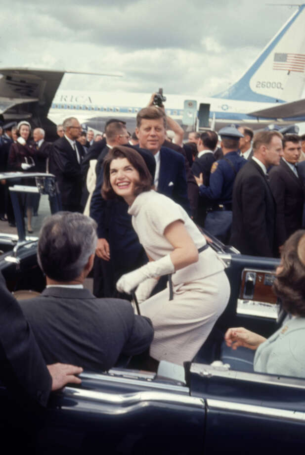 Jacqueline Kennedy laughs as she gets into car with her husband President John F. Kennedy at San Antonio International Airport on Nov. 21, 1963. Photo: Art Rickerby, Time & Life Pictures Via Getty Images / Time & Life Pictures